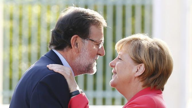 German Chancellor Merkel welcomes Spanish Prime Minister Rajoy at the German government's guesthouse in Meseberg