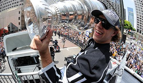 Los Angeles Kings' Anze Kopitar hoists the Stanley Cup