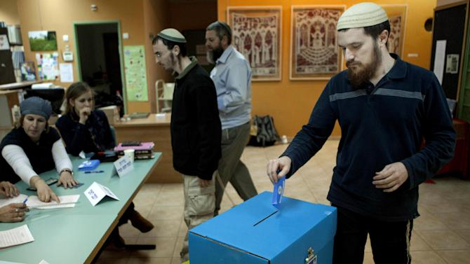 Israeli Jewish settler votes inthe settlement of Elon Moreh in the West Bank, during legislative elections, Tuesday, Jan. 22, 2013. Israelis voted Tuesday in an election expected to keep hard-line Prime Minister Benjamin Netanyahu at the helm of government for a third term despite his rocky record: No peace process with Palestinians, growing diplomatic isolation and signs of economic trouble ahead. (AP Photo/Dan Balilty)
