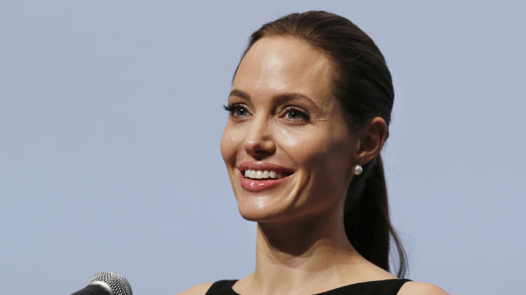 "Angelina Jolie delivers a statement before screening the film ""In the Land of Blood and Honey"" directed by her, at the United Nations University in Tokyo Monday, July 29, 2013. (AP Photo/Koji Sasahara)"