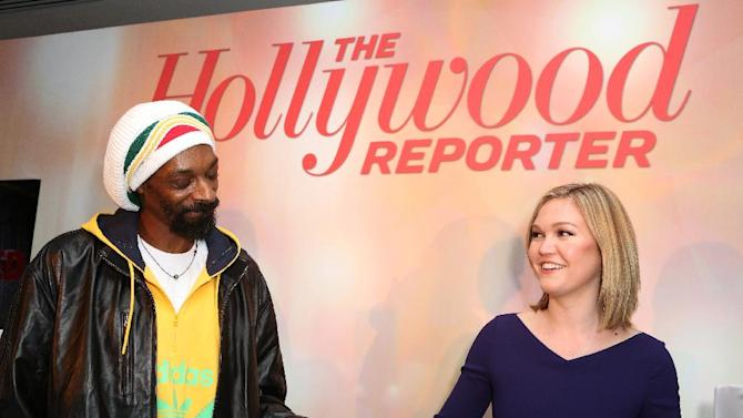 Snoop Dogg, AKA Snoop Lion, left, and Julia Stiles perform at The Hollywood Reporter Nominees' Night Insider at Spago on Monday, Feb. 4, 2013, in Beverly Hills, Calif. (Photo by Casey Rodgers/Invision for The Hollywood Reporter/AP Images)