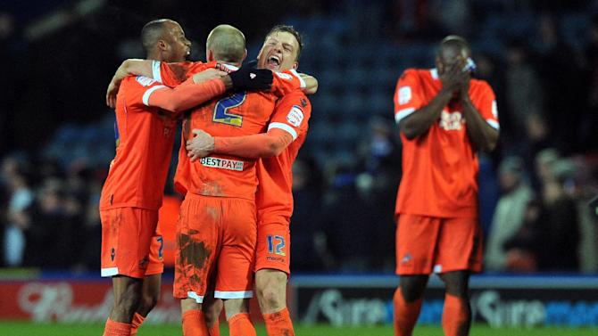 Millwall players celebrate their 1-0 win over Blackburn Rovers' Jordan Rhodes at the end of their English FA Cup quarter-final football match replay in Blackburn, northwest England on March 13, 2013