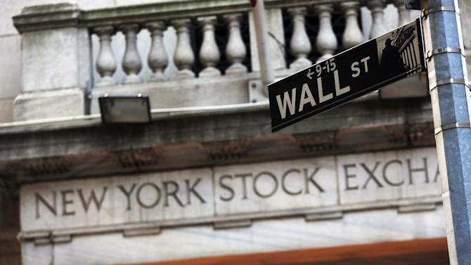 A Wall Street sign is seen in front of the New York Stock Exchange in New York's financial district