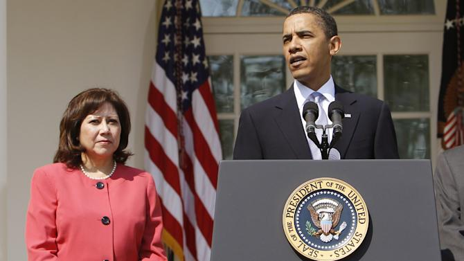 FILE - This April 15, 2010 file photo shows Labor Secretary Hilda Solis standing with President Barack Obama in the Rose Garden of the White House in Washington. Solis is telling colleagues she is leaving the Obama administration.  (AP Photo/Charles Dharapak, File)
