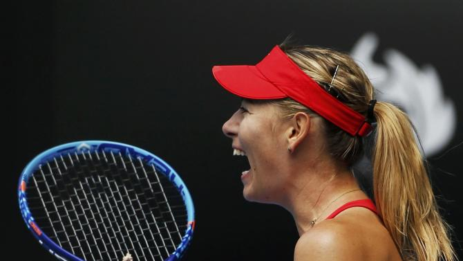 Sharapova of Russia celebrates after defeating compatriot Makarova in their women's singles semi-final match at the Australian Open 2015 tennis tournament in Melbourne