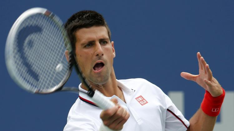 Novak Djokovic of Serbia hits a return to Sam Querrey of the U.S. during their match at the 2014 U.S. Open tennis tournament in New York