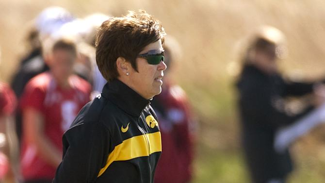 In this photo provided by the University of Iowa athletics department Hawkeyes, women's field hockey coach Tracey Griesbaum watches the team from the sidelines. Griesbaum, who led the Hawkeyes to success during a 14-year tenure, says she was fired after a group of former players falsely claimed that she mistreated them and that she did nothing to warrant being relieved from her post. (AP Photo/University of Iowa)