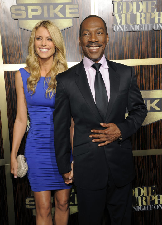 Eddie Murphy arrives with his date Paige Butcher at