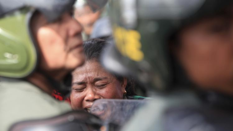 A woman cries during a protest in front of the building of Cambodia's prime minister's office in Phnom Penh