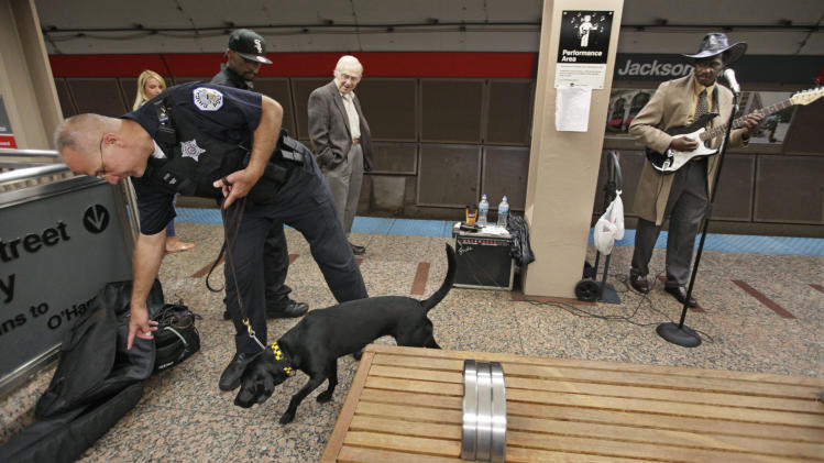 In this photo taken Wednesday, Sept. 7, 2011, Chicago Police Officer Nick Spencer and K-9 officer, Ggillis, patrol a platform in a downtown Chicago subway system station. Ggillis, a 3-year-old Labrador, is named after New York City police Sgt. Rodney Gillis who was killed in the September 11, 2001, terrorist attacks while attempting to rescue the victims trapped in the World Trade Center. (AP Photo/M. Spencer Green)