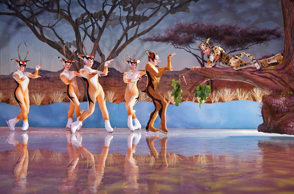 "This undated photo provided by Busch Gardens Tampa Bay & Adventure Island shows performers in a scene from ""Iceploration,"" a new elaborate ice show at the theme park. The show is one of a number of new attractions at theme parks around the country this season. (AP Photo/Busch Gardens, Matt Marriott)"