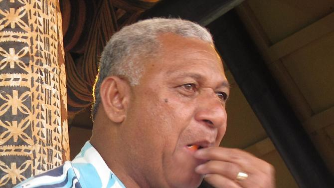 In this Nov. 7, 2013 photo, Fiji's Prime Minister Voreqe Bainimarama eats cake at the opening of a picnic park, in Suva, Fiji. Thousands of Fijians are eagerly awaiting their first chance to vote in nearly eight years Wednesday in an election that promises to finally restore democracy to the South Pacific nation of 900,000. Yet plenty of questions remain about how far military ruler Bainimarama has tilted the outcome in his favor. Bainimarama is running as a candidate and polls indicate his party is by far the most popular of the seven registered.  (AP Photo/Nick Perry, File)
