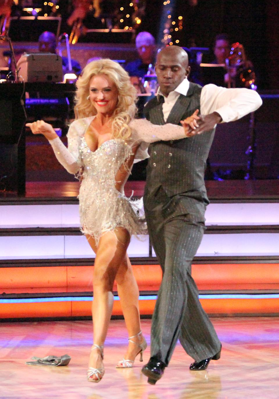"This Monday, May 14, 2012 photo shows Donald Driver, right, and his partner Peta Murgatroyd performing on the celebrity dance competition series ""Dancing with the Stars,"" in Los Angeles. (AP Photo/ABC, Adam Taylor)"