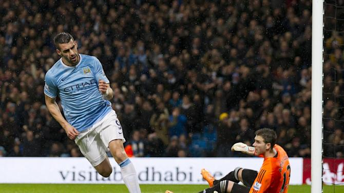 Manchester City's Alvaro Negredo celebrates after scoring past West Ham United's goalkeeper Adrian during their English League Cup semifinal soccer match at the Etihad Stadium, Manchester, England, Wednesday Jan. 8, 2014