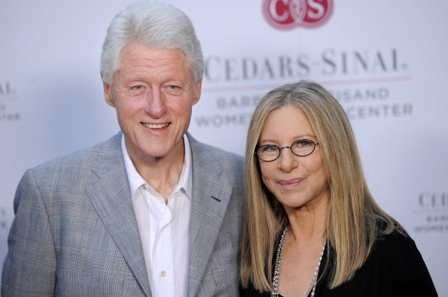 Former President Bill Clinton poses with Barbra Streisand at the dedication of the Barbra Streisand Women's Heart Center in the Cedars-Sinai Heart Institute, on Thursday June 14, 2012, at Streisand's home in Malibu, Calif. (Photo by Chris Pizzello/Invision/AP)
