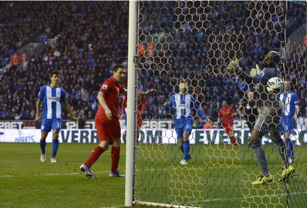 Liverpool's Stewart Downing heads to score against Wigan Athletic during their English Premier League soccer match in Wigan