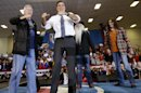 Republican presidential candidate and former Massachusetts Gov. Mitt Romney stands on stage with The Oak Ridge Boys as he campaigns at the Veterans Memorial Coliseum, Marion County Fairgrounds, in Marion, Ohio, Sunday, Oct. 28, 2012. (AP Photo/Charles Dharapak)