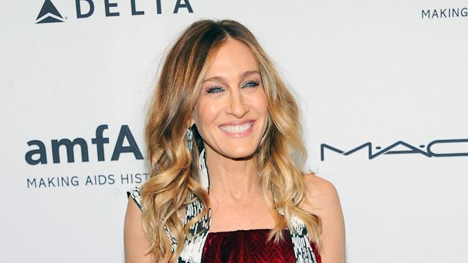 "FILE - This Feb. 6, 2013 file photo shows actress Sarah Jessica Parker at amfAR's New York gala at Cipriani Wall Street in New York. AOL is making its most substantial dip into original video programming with new series with Sarah Jessica Parker, Gwyneth Paltrow, Hank Azaria and Nicole Richie. The Internet company unveiled 15 new digital series Tuesday, April 30, in a presentation to advertisers in New York. AOL is making a push into original programming in the wake of similar efforts by YouTube, Yahoo and Amazon.  Parker will produced a docudrama on the New York City Ballet titled ""City.Ballet."" Paltrow and Tracy Anderson will host the Ryan Seacrest-produced series ""Second Chances,"" in which they interview women who've overcome hardship.  (Photo by Evan Agostini/Invision/AP, file)"