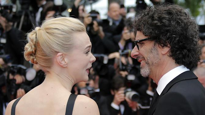 Actress Carey Mulligan, left, and Joel Coen speak as they arrive for the screening of the film Inside Llewyn Davis at the 66th international film festival, in Cannes, southern France, Sunday, May 19, 2013. (AP Photo/Lionel Cironneau)
