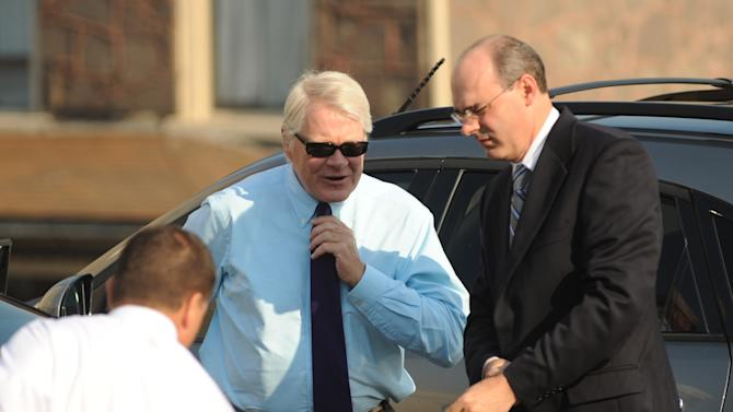 Prosecutor Joseph E. McGettigan III, center, arrives at the Centre County Courthouse with the rest of his prosecution team, in Bellefonte, Pa., Wednesday, June 20, 2012 for former Penn State University assistant football coach Jerry Sandusky's trial. Sandusky is charged with 51 counts of child sexual abuse involving 10 boys over a period of 15 years. (AP Photo/Centre Daily Times, Nabil K. Mark)
