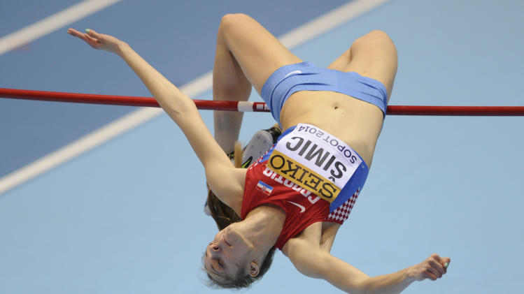 Croatia's Ana Simic makes an attempt in the qualification for the women's high jump during the Athletics Indoor World Championships in Sopot, Poland, Friday, March 7, 2014. (AP Photo/Alik Keplicz)