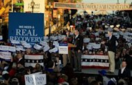 US Republican presidential candidate Mitt Romney (C) and US Republican vice presidential candidate Paul Ryan (L) attend a rally in Lancaster, Ohio, on October 12. Romney took his campaign into the weekend with a spring in his step, as US President Barack Obama went behind closed doors to prepare for a crucial debate