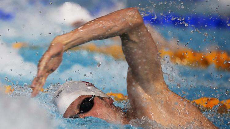Canada's Ryan Cochrane swims to a gold medal in the men's 400 meter freestyle event in the Commonwealth Games at Tollcross Swimming Centre in Glasgow, Scotland on Thursday, July 24, 2014. (AP Photo/The Canadian Press, Andrew Vaughan)