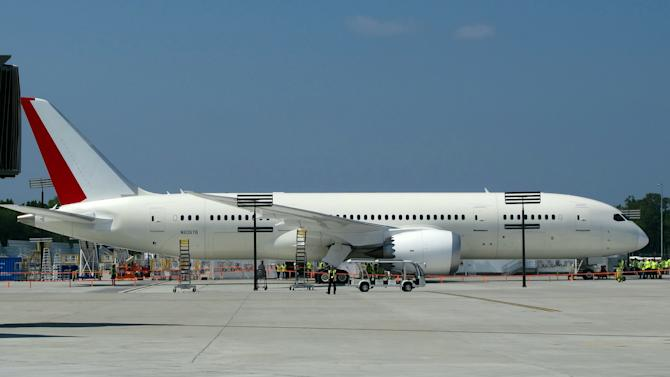 The first Boeing 787 manufactured in South Carolina is parked outside the Boeing plant in North Charleston, S.C., before its maiden flight on Wednesday, May 23, 2012.  It's the first plane manufactured at the $750 million assembly plant that opened last summer.   (AP Photo/Bruce Smith)
