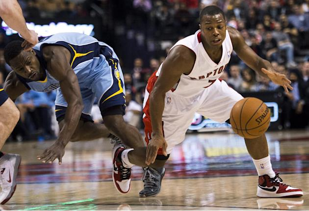 Toronto Raptors guard Kyle Lowry, right, moves past Memphis Grizzlies guard Tony Allen, left, during first half NBA basketball action in Toronto on Friday, March. 14, 2014