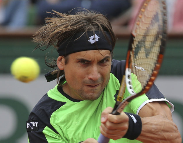 Spain s David Ferrer returns the ball to compatriot Rafael Nadal during the  men s final match of 1f05320c0190