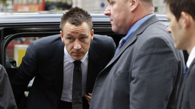 """Former England soccer captain and Chelsea player John Terry, center, arrives at Westminster Magistrates Courts in London, Tuesday, July 10, 2012. The racism trial of Terry began Monday with prosecutors claiming the Chelsea captain acknowledges using offensive language as a """"sarcastic exclamation"""" in response to taunts that he allegedly had an affair. The England defender is accused of racially abusing Queens Park Rangers defender Anton Ferdinand, who is black, during a Premier League match in October.  (AP Photo/Sang Tan)"""