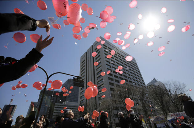 Anti-nuclear protesters release balloons during a rally in front of the Ministry of Economy, Trade and Industry (METI) in Tokyo, Tuesday, March 11, 2014. METI governs Japan's Nuclear and Industria
