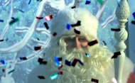 "An actor dressed as Ded Moroz (Grandfather Frost), the Russian Santa Claus, smiles through smoke from a firecracker and flying confetti during a welcome ceremony for him in Moscow's Gorky Park, on December 24, 2012. Pope Benedict XVI on Tuesday called for an ""end to the bloodshed"" in conflict-wracked Syria in a traditional Christmas message that touched on several other conflict zones."