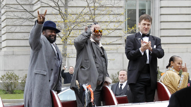 George Clinton, left, arrives for the 2012 Rock and Roll Hall of Fame induction ceremony in Cleveland on Saturday, April 14, 2012. (AP Photo/Amy Sancetta)