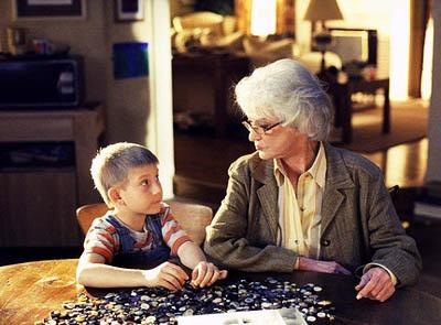 "Dewey (Erik Per Sullivan, L) and his babysitter (Bea Arthur, R) bond over a jigsaw puzzle on the ""Water Park"" episode of Fox's Malcolm In The Middle"