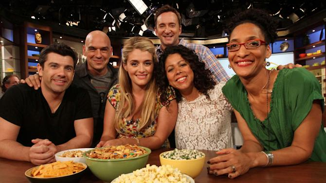 "This Friday, Aug. 26, 2011 photo shows, from left to right, Danny Boome, Iron Chef Michael Symon, Daphne Oz, Clinton Kelly, Evette Rios and Carla Hall as they pose for a photograph following a rehearsal of ABC's ""The Chew"" in New York. Symon, Oz, Kelly and Hall are co-hosts of the show.  Boome and Rios are the show's correspondents. Can some of food and style TV's biggest stars help ABC soap fans get over cancellation of their favorite stories? The network's counting on it for ""The Chew.""     (AP Photo/Tina Fineberg)"