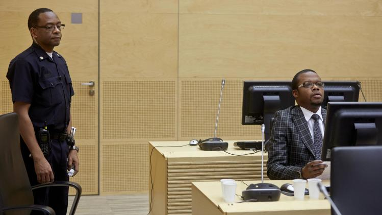 Jean-Jacques Mangenda Kabongo of the Democratic Republic of Congo attends an initial appearance at the ICC in The Hague
