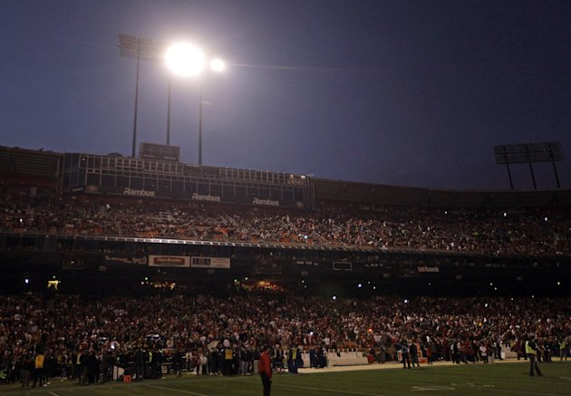 Fans and officials wait at Candlestick Park during a power outage before an NFL football game between the San Francisco 49ers and the Pittsburgh Steelers in San Francisco, Monday, Dec. 19, 2011. (AP P