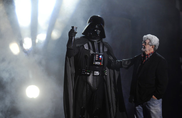 """Darth Vader"" accepts the Ultimate Villain award from ""Star Wars"" creator George Lucas during the 2011 Scream Awards, Saturday, Oct. 15, 2011, in Los Angeles. The award show is dedicated to the horror, science fiction and fantasy genres of feature films, television and comic books. (AP Photo/Chris Pizzello)"