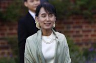 Myanmar democracy icon Aung San Suu Kyi arrives at a reception at St Hugh&#39;s College in Oxford. Suu Kyi was to be awarded an honorary doctorate by Oxford University in the city where she studied and brought up the family she would later leave behind