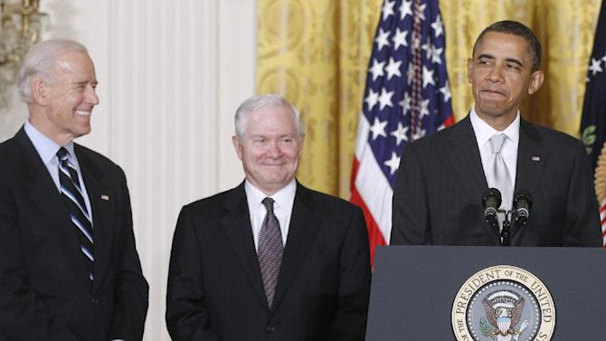 FILE - In this April 28. 2011 file photo, President Barack Obama stands in the East Room of the White House in Washington with, from left: Vice President Joe Biden and outgoing Defense Secretary Robert Gates. The White House is bristling over former Defense Secretary Robert Gates' new memoir accusing President Barack Obama of showing too little enthusiasm for the U.S. war mission in Afghanistan and sharply criticizing Vice President Joe Biden's foreign policy instincts. (AP Photo/Charles Dharapak)