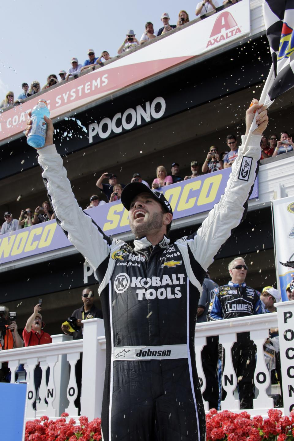Jimmie Johnson celebrates in Victory Lane after winning the NASCAR Pocono 400 auto race on Sunday, June 9, 2013, in Long Pond, Pa. (AP Photo/Russ Hamilton Sr.)