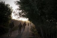 US Marines and Afghan soldiers conduct a joint patrol of Helmand province in 2010. Indian officials are worried the departure of most of the US-led force could leave a dangerous vacuum in Afghanistan, and question if the Kabul government and its fledgling army will be able to fend off Taliban insurgents