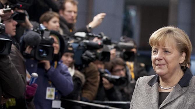 German Chancellor Angela Merkel arrives for an EU summit in Brussels on Thursday, Dec. 13, 2012. In one whirlwind morning, the European Union nations agreed on the foundation of a fully-fledged banking union and Greece's euro partners approved billions of euros in bailout loans that will prevent the nation from going bankrupt. (AP Photo/Virginia Mayo)