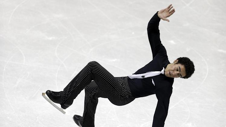 Philip Warrenl falls after a jump in the senior men's short program at the U.S. figure skating championships in Omaha, Neb., Friday, Jan. 25, 2013. (AP Photo/Nati Harnik)