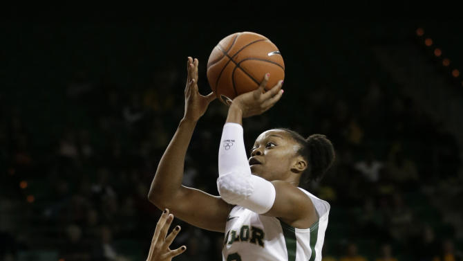 FILE - In this Dec. 12, 2012 file photo, Baylor guard Odyssey Sims (0) attempts a shot as Oral Roberts guard Kevi Luper, rear, watches in the second half of an NCAA college basketball game in Waco, Texas. Sims was selected to the 2012-13 AP Women's All-America team, Tuesday, April 2, 2013. (AP Photo/Tony Gutierrez, File)