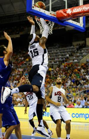Carmelo Anthony of the US Men's Senior National Team, center, dives for the ball against Jose Manuel Calderon, left, of Spain Men's Senior National Team during an exhibition match between Spain and the United States Tuesday, July 24, 2012, in Barcelona, Spain, in preparation for the 2012 Summer Olympics. (AP Photo/Manu Fernandez)