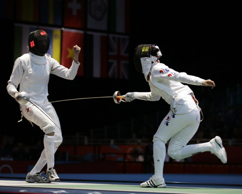 Canada's Sherraine Schalm faces South Korea's A Lam Shin during a women's individual epee fencing round of 32 match at the 2012 Summer Olympics, Monday, July 30, 2012, in London. (AP Photo/Andrew Medichini)