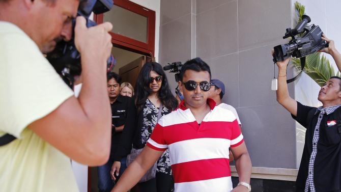 The brother and sister of Australian death row prisoner Sukumaran leave after visiting him in prison in Denpasar