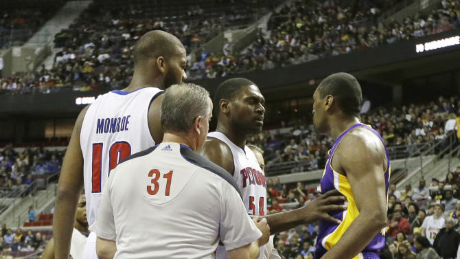 Detroit Pistons forward Jason Maxiell (54) and teammates confront Los Angeles Lakers forward Metta World Peace after his flagrant foul on Pistons guard Brandon Knight during the first quarter of an NBA basketball game at the Palace of Auburn Hills, Mich., Sunday, Feb. 3, 2013. (AP Photo/Carlos Osorio)